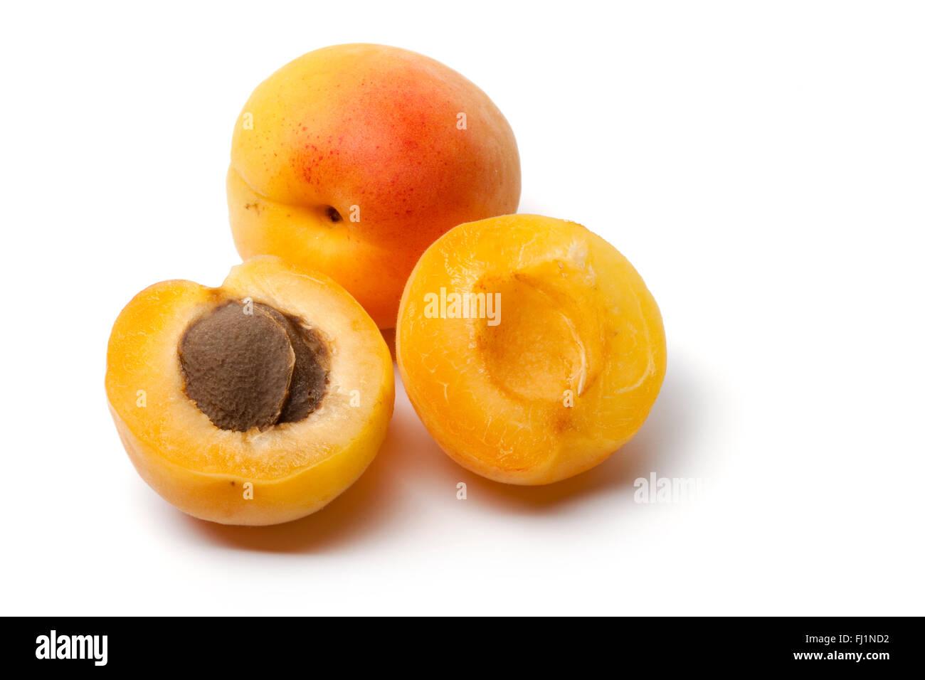 Whole and half fresh apricot isolated on white background - Stock Image