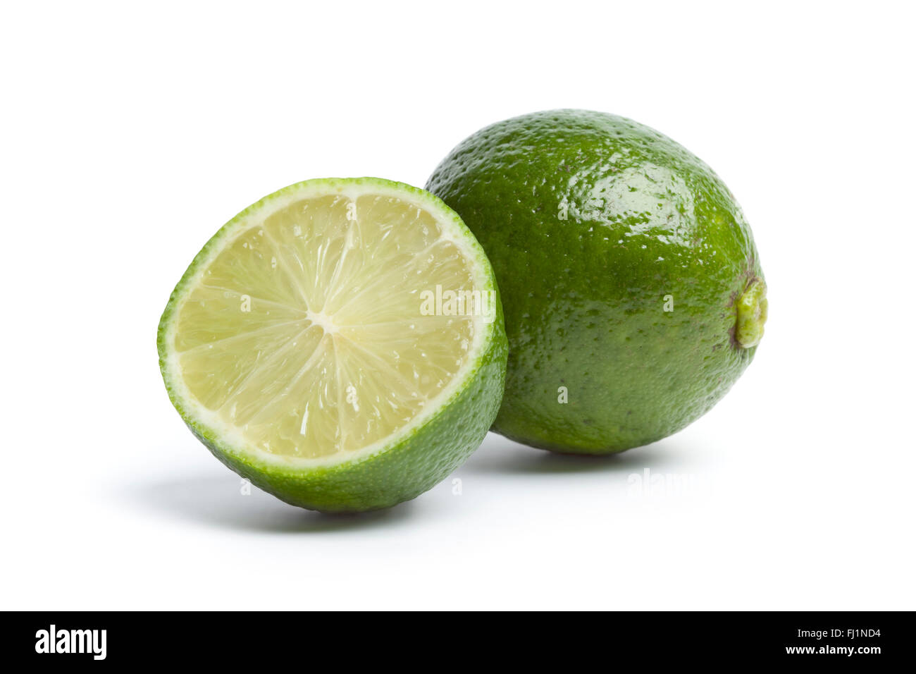 One and a half fresh lime isolated on white background - Stock Image