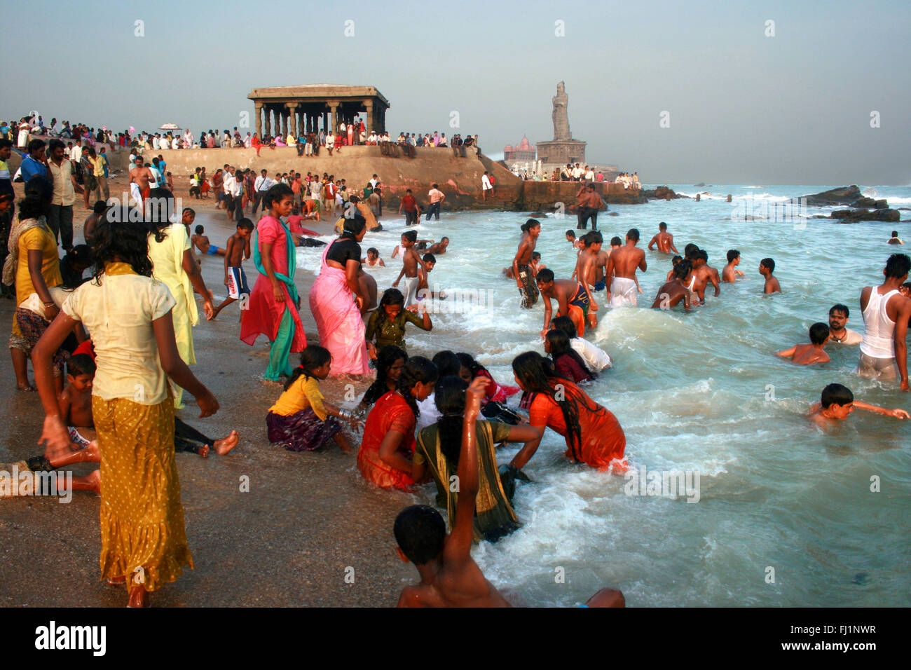 People are bathing in the holy waters of the Indian ocean in Kanyakumari , India - Stock Image