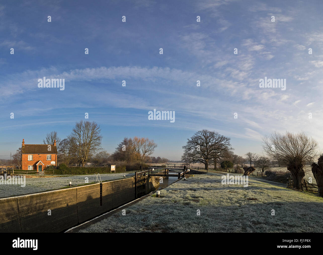Papercourt lock and weir on the River Wey navigation in Surrey on a still clear frosty winters morning - Stock Image