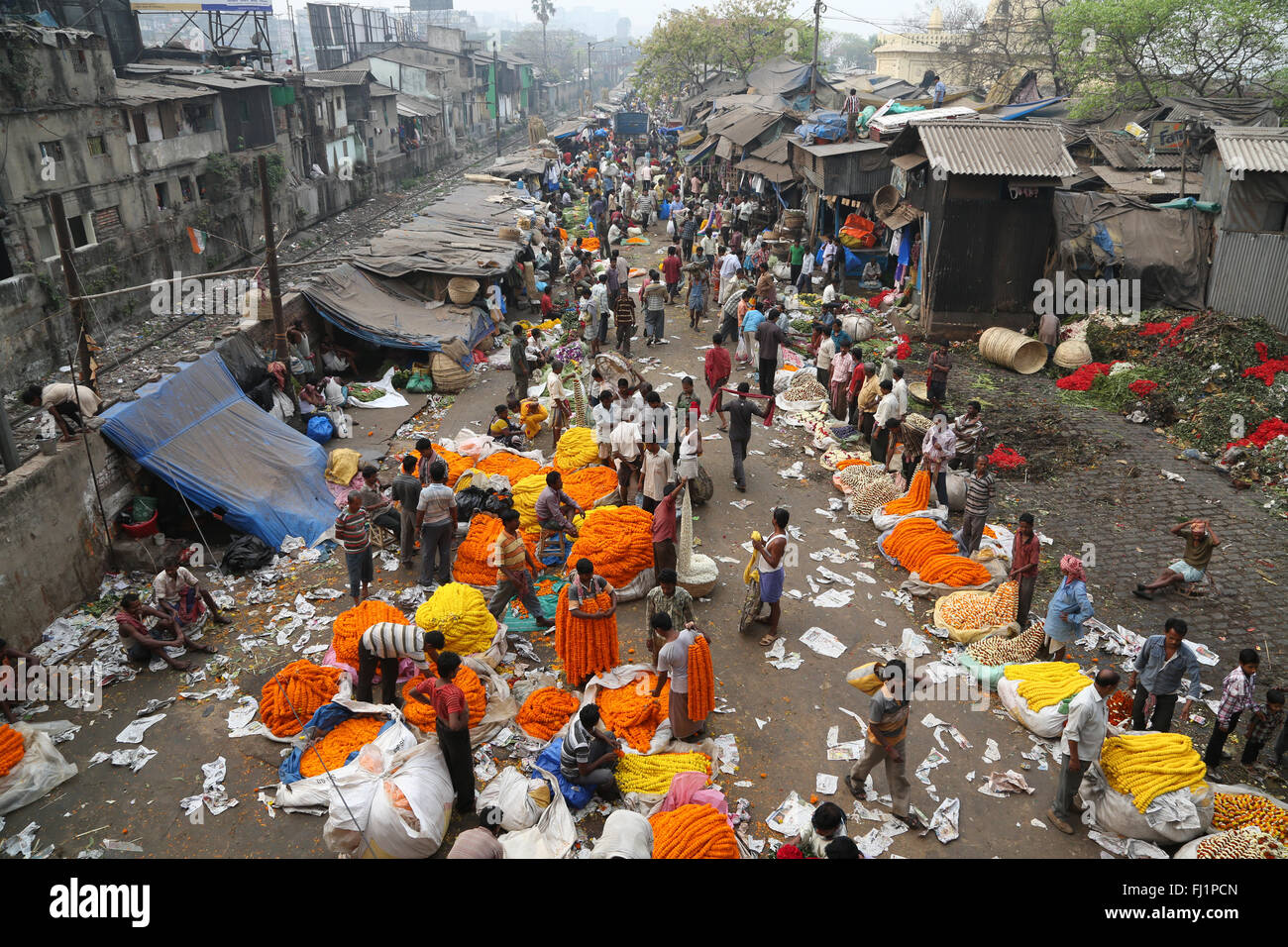 Crowd and people at the Kolkata Mullick ghat flower market , India - Stock Image