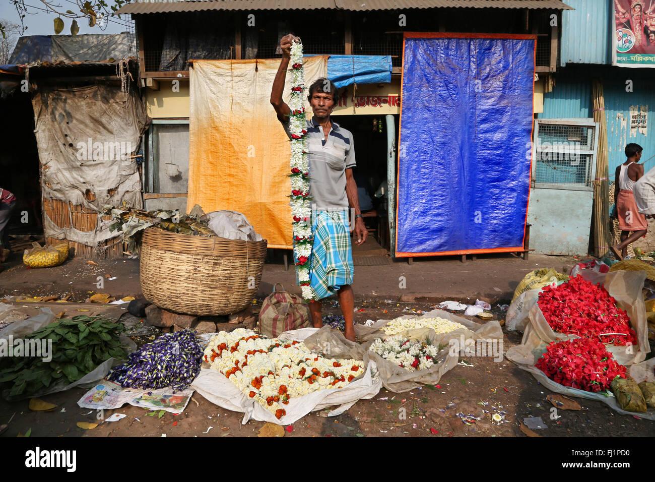 Flower seller at the Kolkata Mullick ghat flower market , India - Stock Image