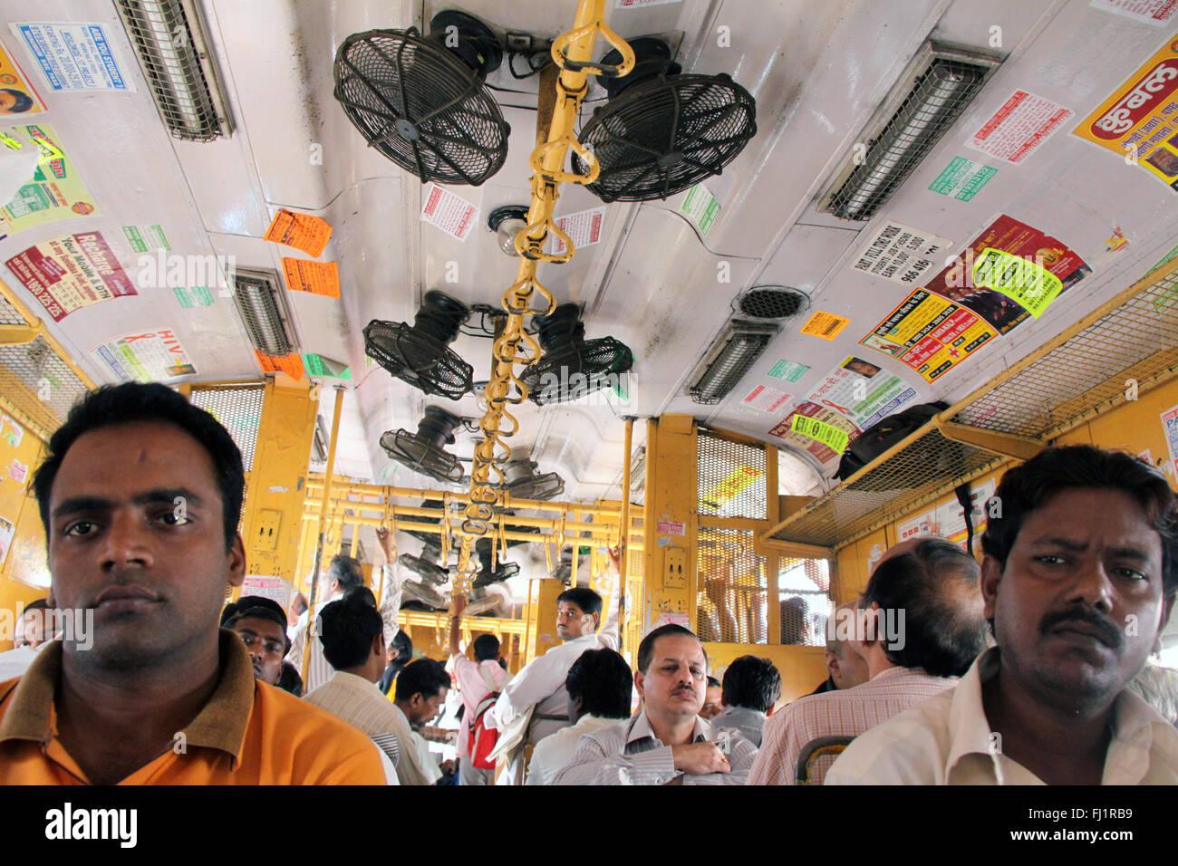 People passengers inside suburban train in Mumbai Bombay, India Stock Photo