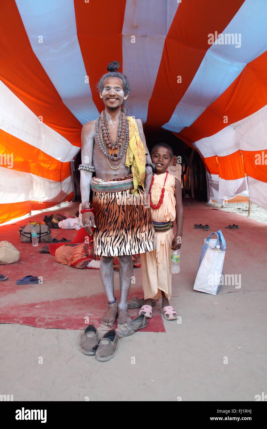 Hindu pilgrims in a tent during Kumbh mela in haridwar , India - Stock Image