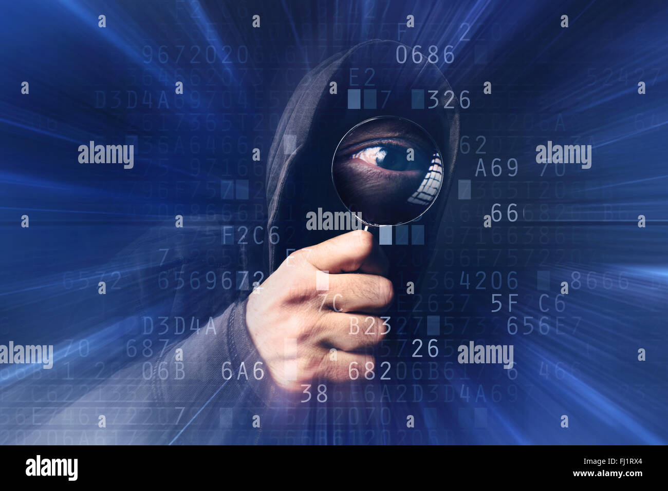 Spyware virus software, bizzare spooky hooded hacker with magnifying glass analyzing computer hexadecimal code, - Stock Image
