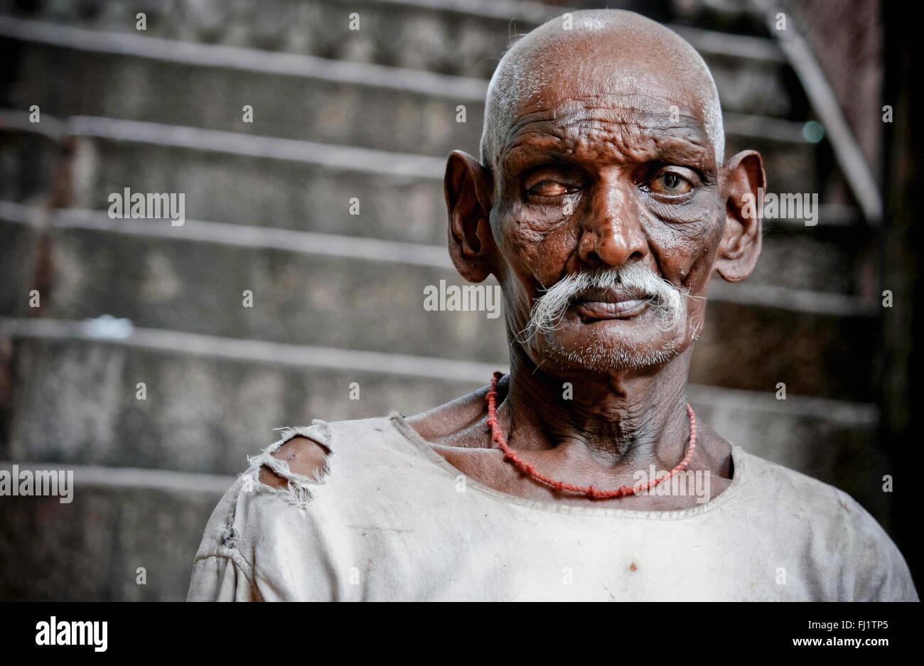 Indian beggar  in Hindu holy city Varanasi, India - Stock Image