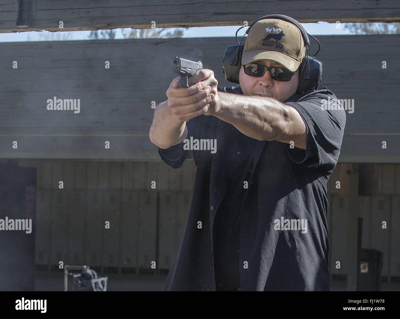Chino, California, USA. 27th Feb, 2016. Steven Pappas of La Palma, Ca. keeps his shooting skills sharp. Pappas, - Stock Image