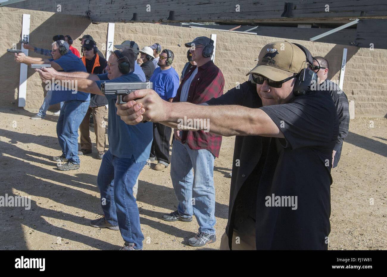 Chino, California, USA. 27th Feb, 2016. Steven Pappas, right, of La Palma, Ca. keeps his shooting skills sharp. - Stock Image