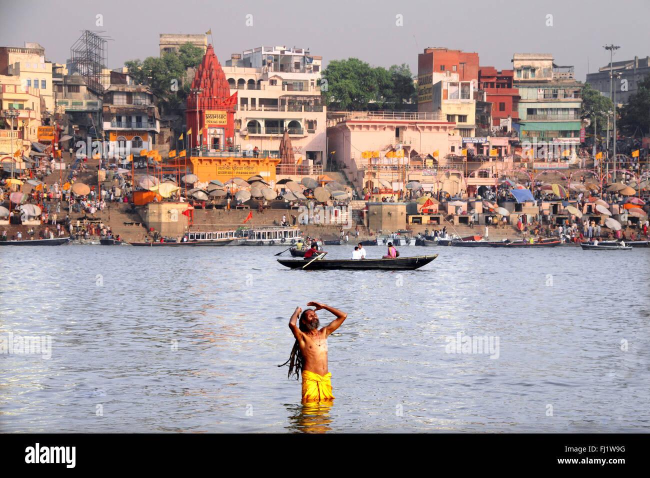 Sadhu in the Ganges in front of Dashashwamedh Ghat , Varanasi - Stock Image