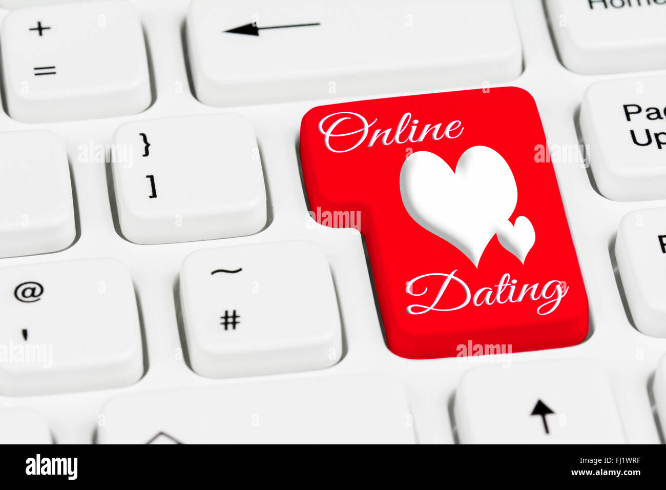 Online dating button on a white computer keyboard. - Stock Image