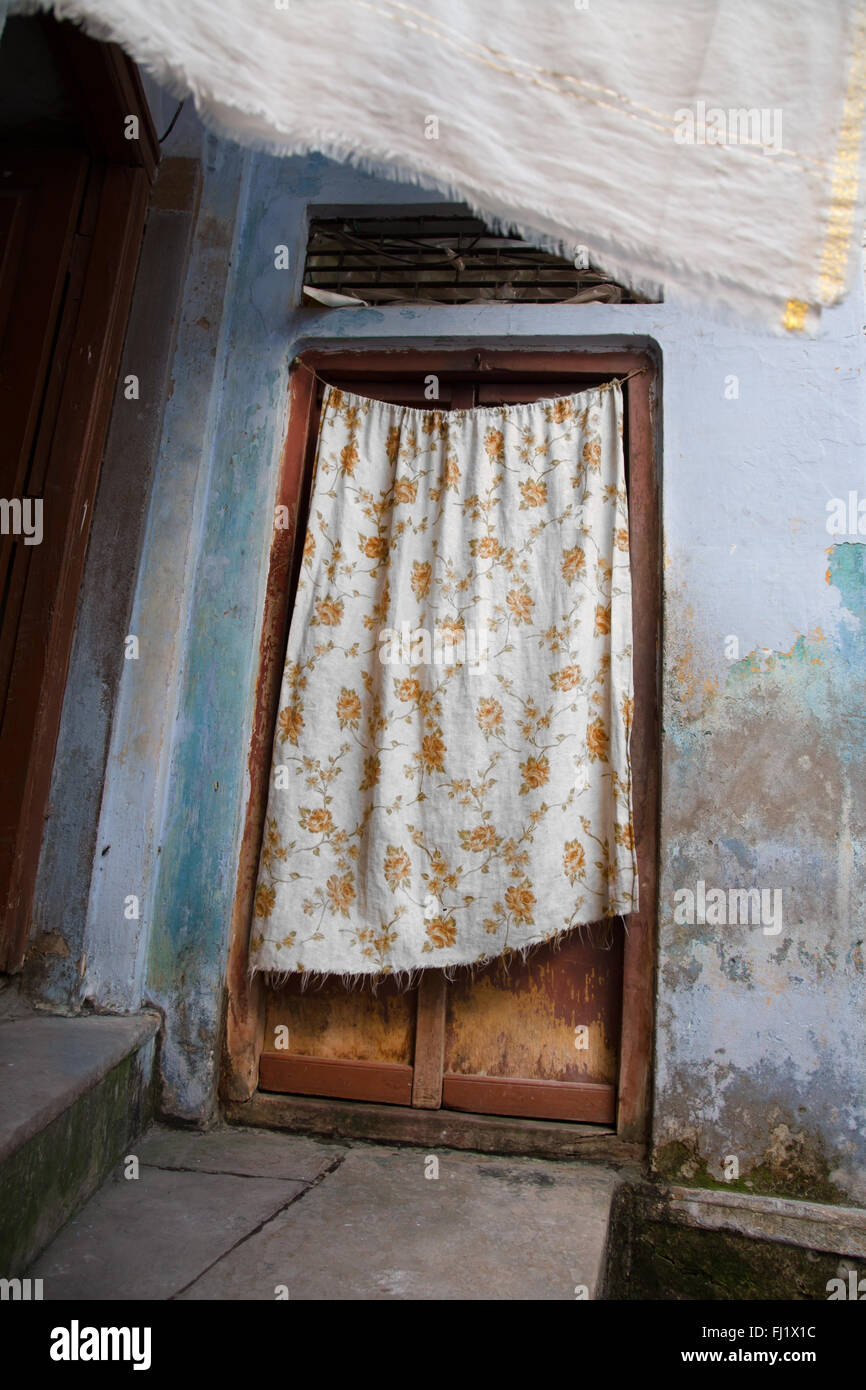Door with sheet in the old city of Varanasi , India - Stock Image
