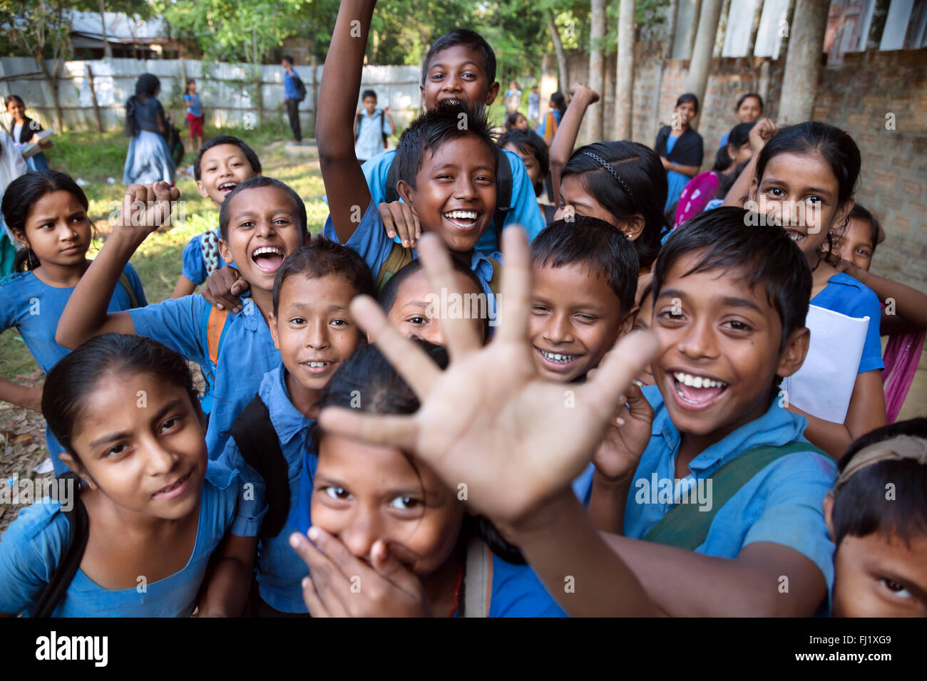 A group of kids go crazy after school in Sreemangal Bangladesh - Stock Image