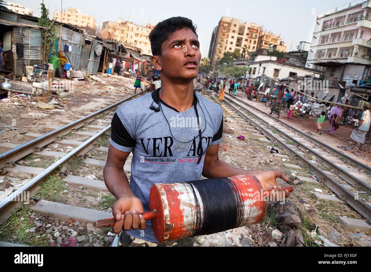 Portrait of Muslim man playing kite  in slums in Dhaka, Bangladesh Stock Photo