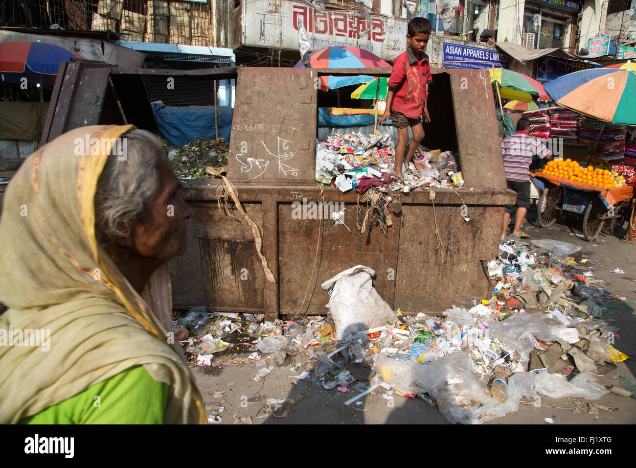Poor kid searches in a garbage dump , Chittagong , Bangladesh - Stock Image