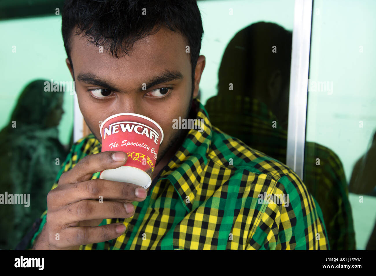 Bangladesh man drinking Newcafé beverage inspired by Nescafé traditional brand , Dhaka - Stock Image