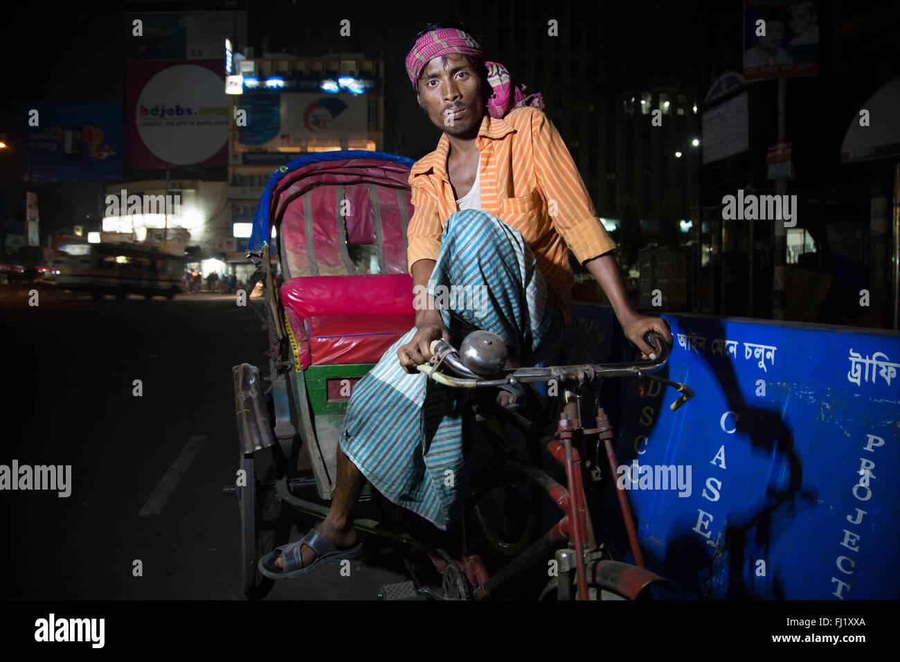 Rickshaw driver in Motijheel area , Dhaka , Bangladesh - Stock Image