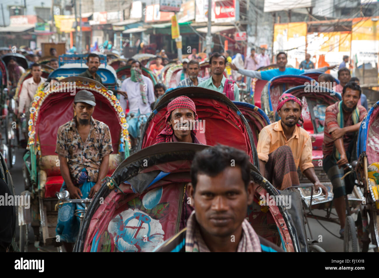 Rickshaw drivers in the traffic in Dhaka , Bangladesh - Stock Image