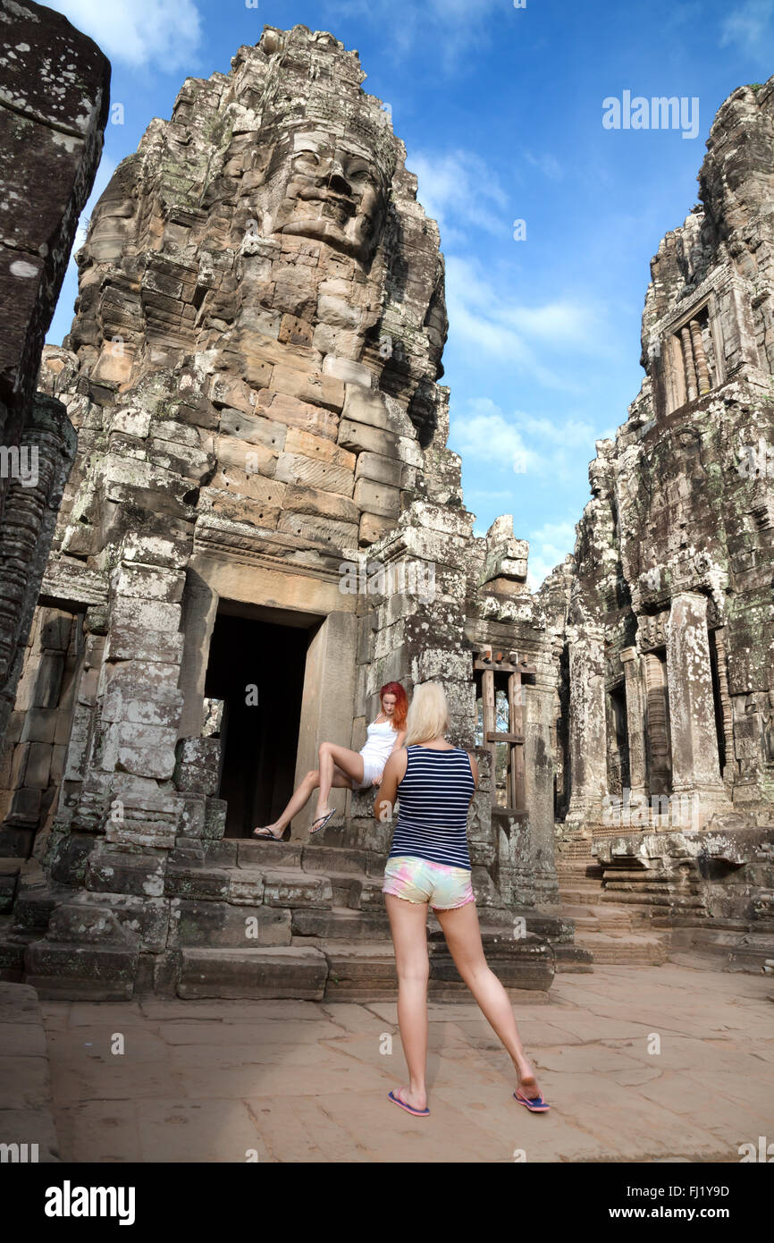 Tourists visiting Bayon Temple, Siem Reap, Cambodia - Stock Image