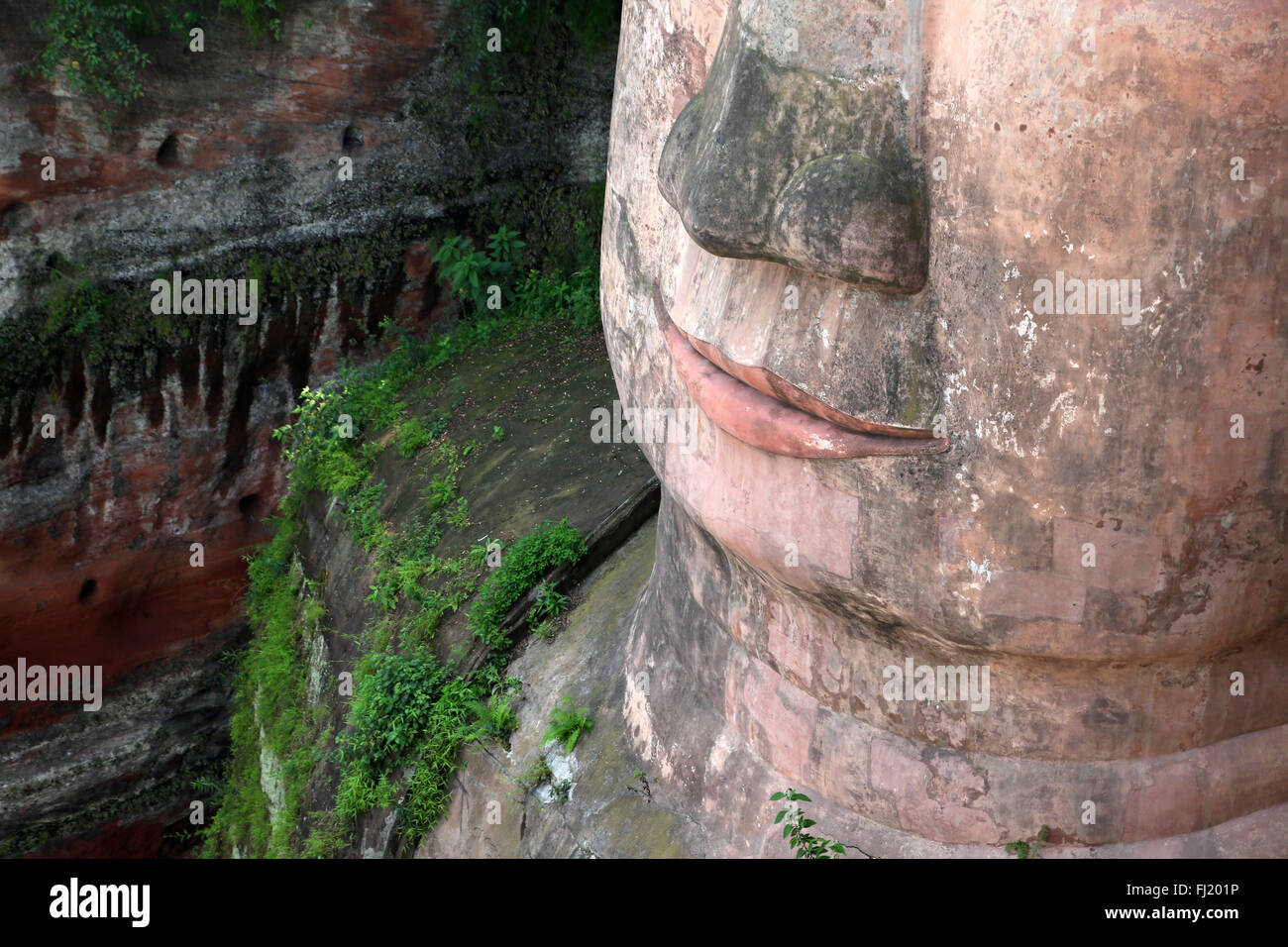 Close up on mouth of Leshan Giant Buddha , Sichuan , China - Stock Image