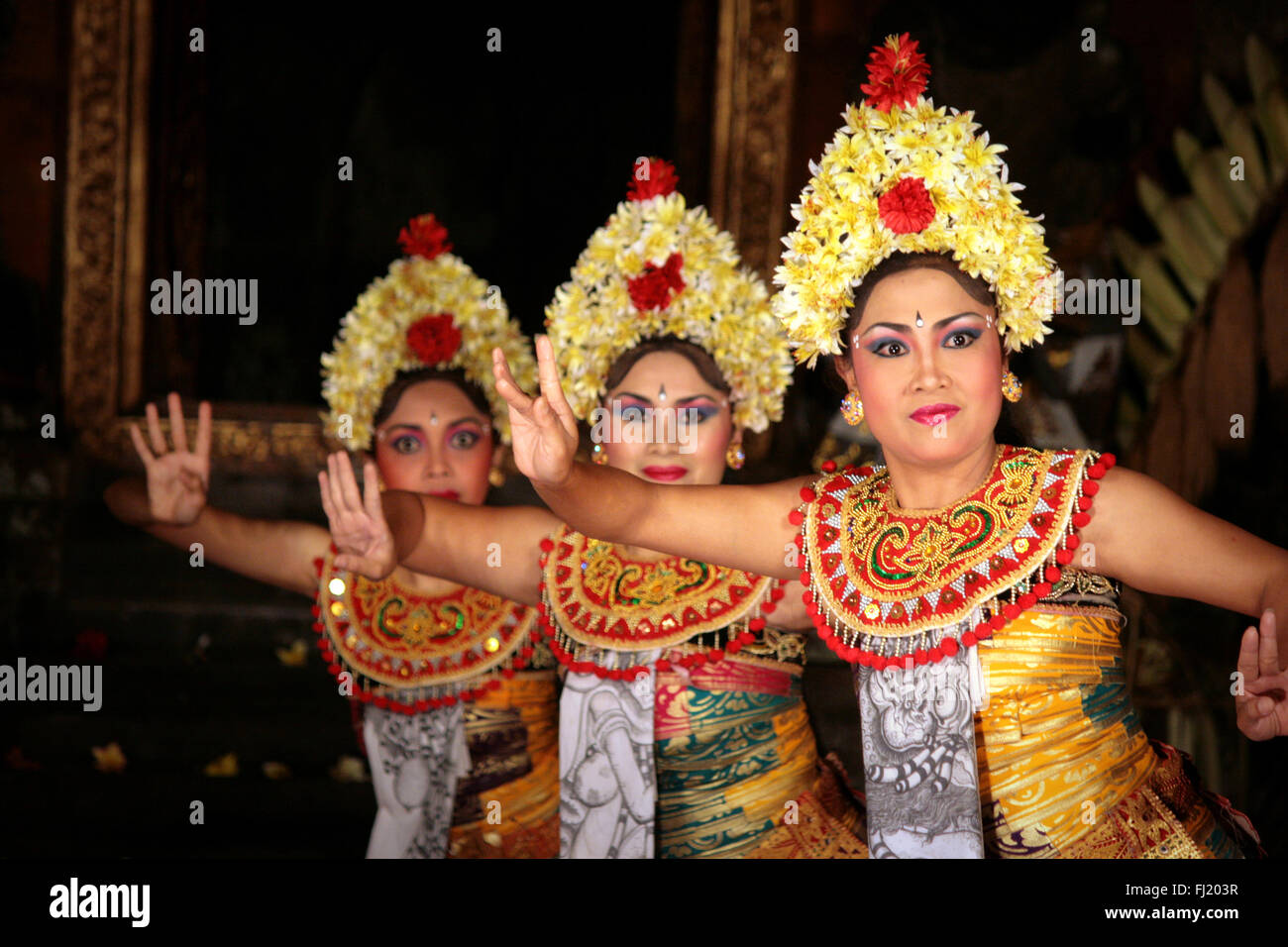 A barong dance performance at outdoor theater at night in Ubud, Bali, Indonesia - Stock Image