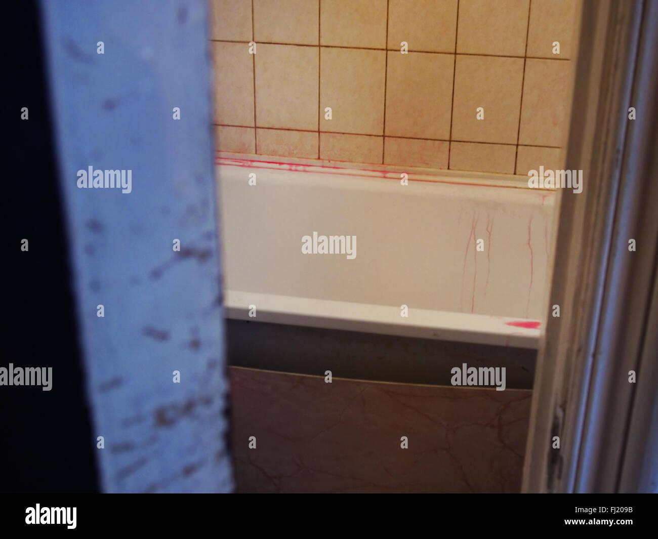 The bathroom in through the door. Tub, like in streaks of blood - Stock Image