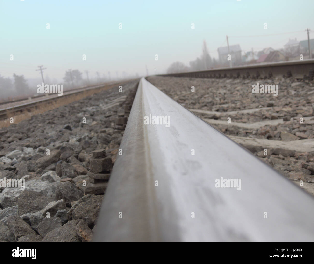 Rails, stretching to the horizon, photographed by a camera, placed on the rail head - Stock Image