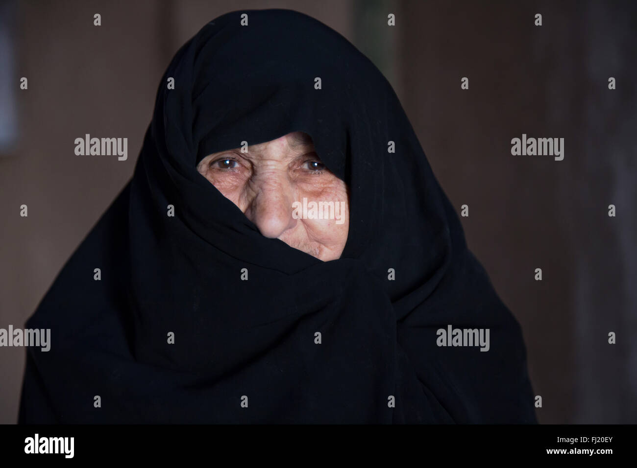 Portrait of old Iranian woman covered with niqab, Iran - Stock Image