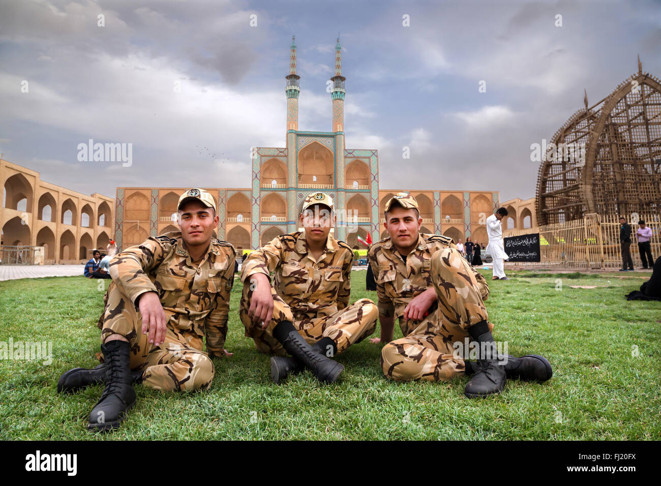 Militaries posing with uniform  in front of the Amir Chakhmagh complex, Yazd , Iran - Stock Image