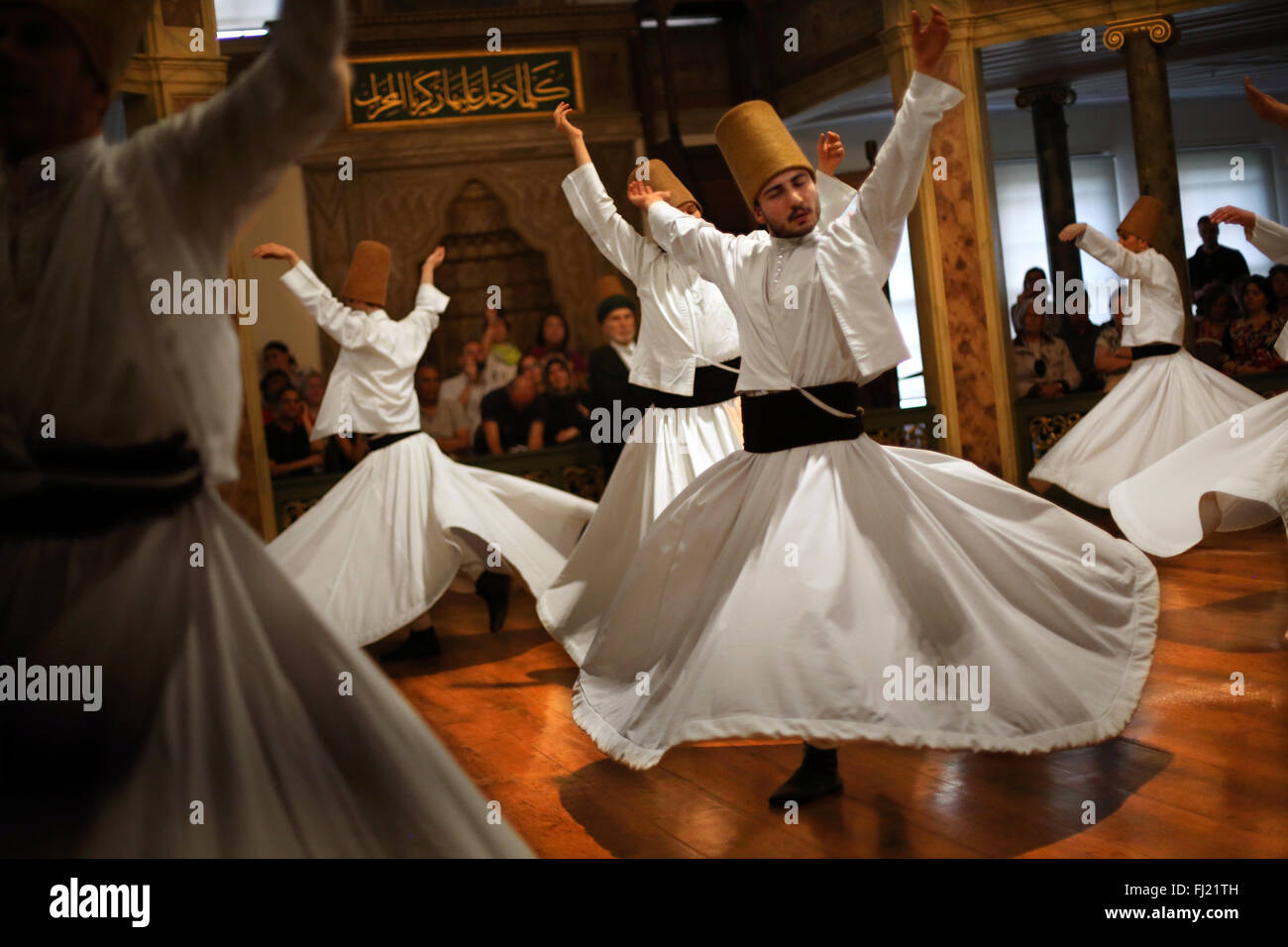 Whirling Dervishes perform at Hodjapasha Culture Centre, Istanbul - Stock Image