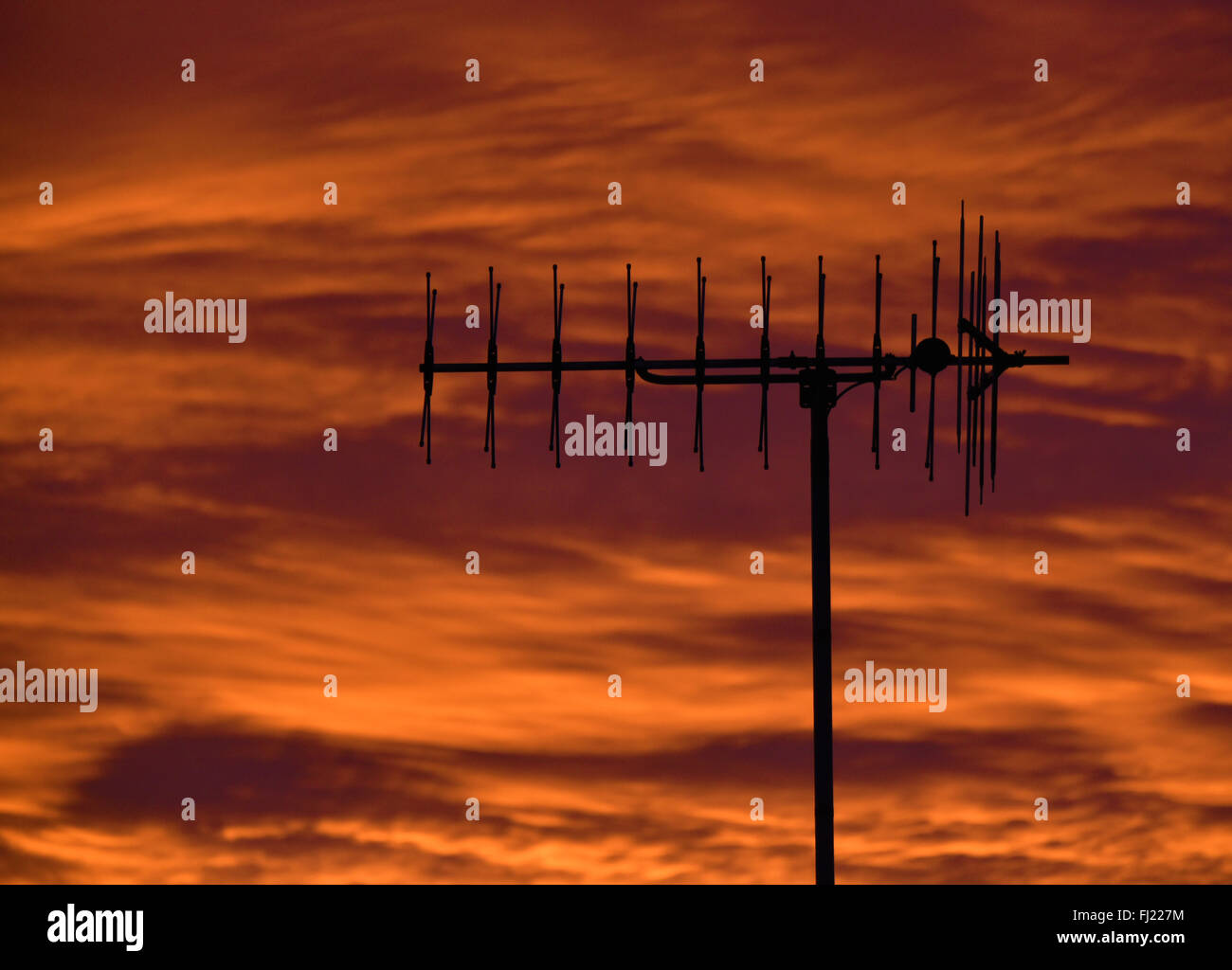 Television aerial with sunset sky. - Stock Image