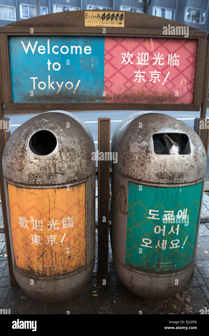 Public trash cans in Tokyo, Japan, with 'welcome to Tokyo' writing - Stock Image