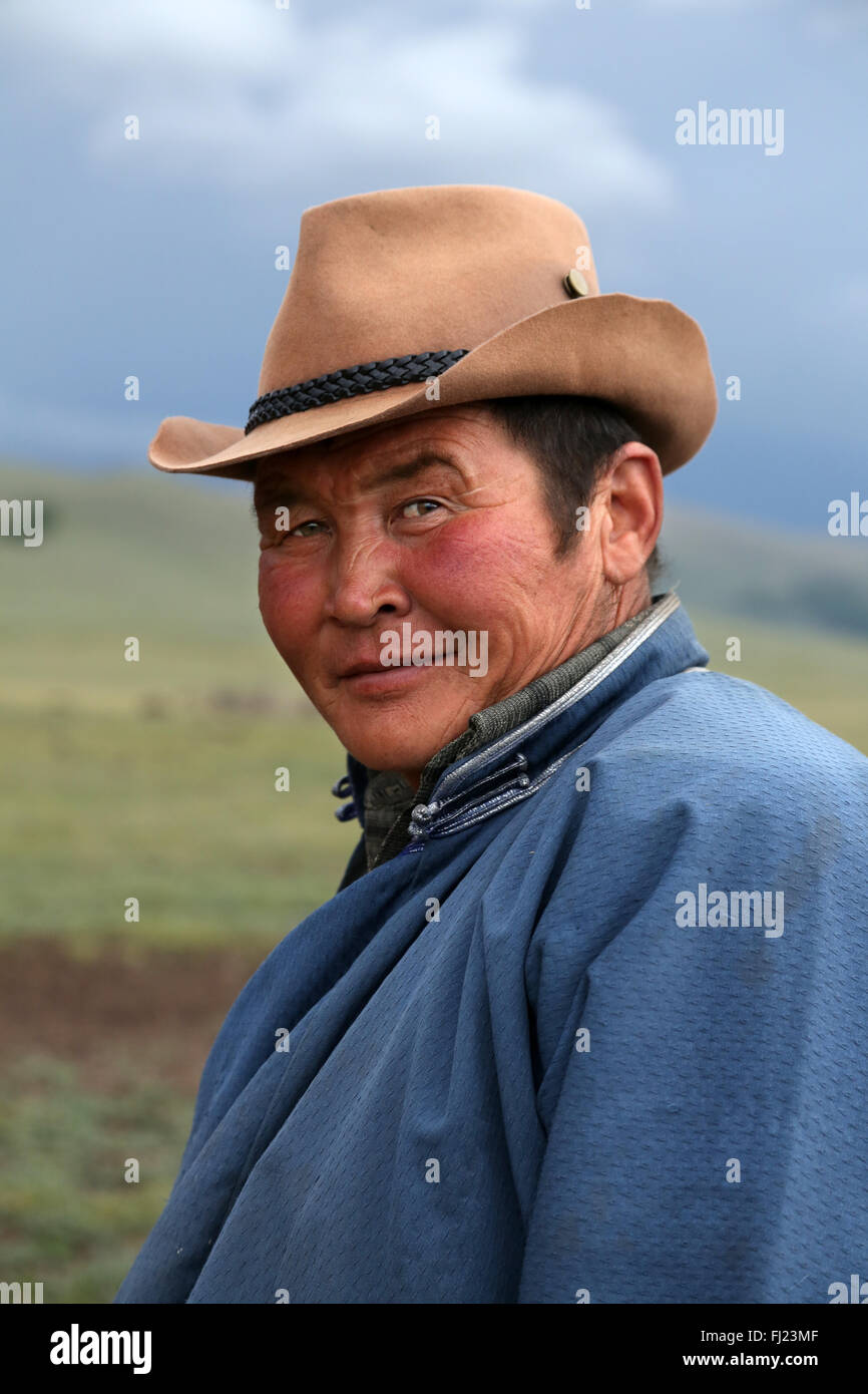 Portrait of man from Mongolia with hat and deel - Stock Image