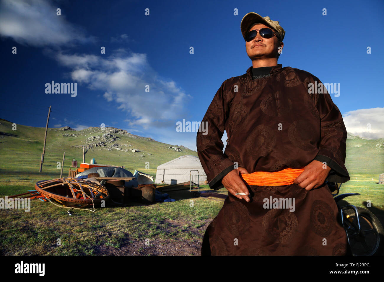 Portrait of Mongolian man with traditional dress costume clothes called 'deel' - Stock Image