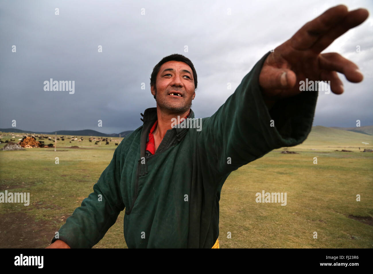 Portrait of Mongolian man with traditional dress clothes called 'deel' - Stock Image