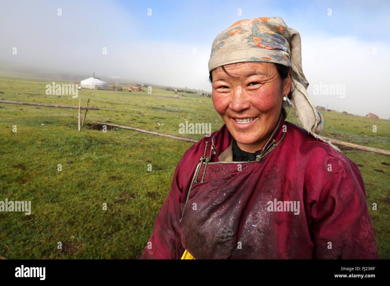 Portrait of Mongolian woman with traditional costume dress called 'deel' - Stock Image