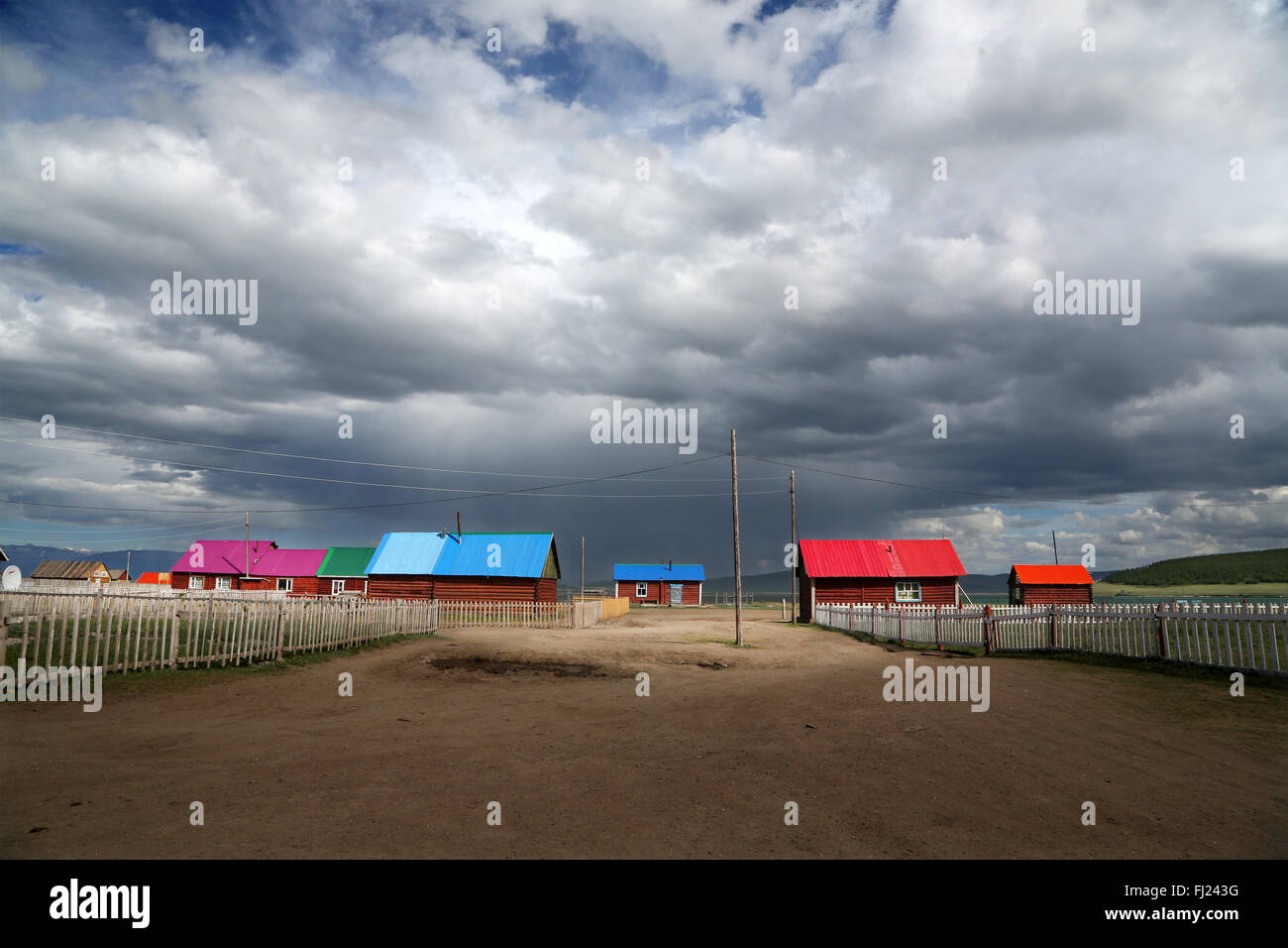 Houses with colored roofs in Tsagaan Nuur village  , Mongolia - Stock Image