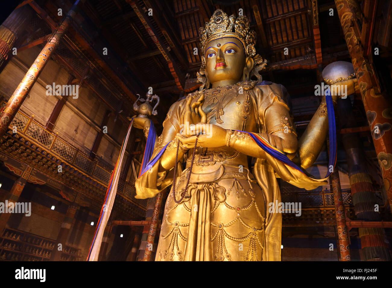 Huge Avalokiteśvara statue in Gandantegchinlen Monastery, Ulaanbaatar, Mongolia - Stock Image
