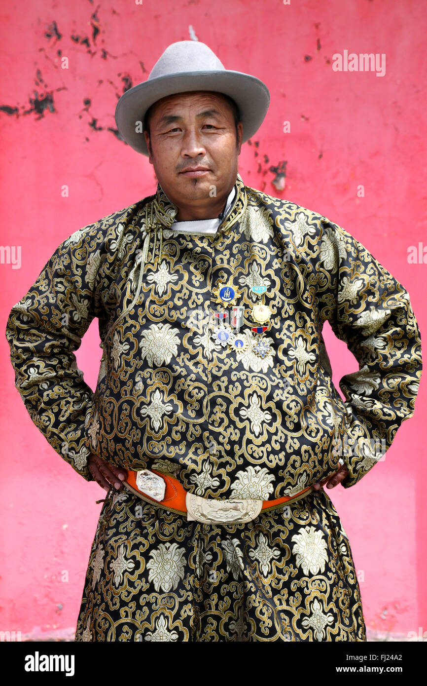 Portrait of Mongolian man with traditional costume dress  called 'deel' - Stock Image