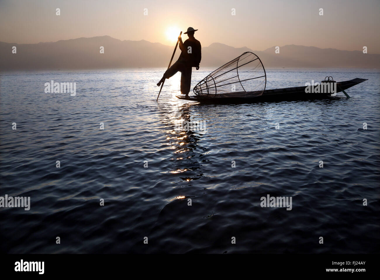 Landscape of Burmese traditional fisherman on Inle lake by sunrise,  Myanmar - Stock Image