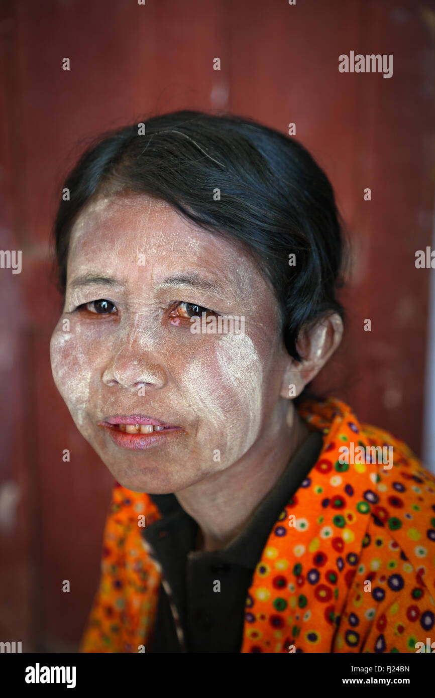 Portrait of woman with thanaka powder on her face in Nyaung