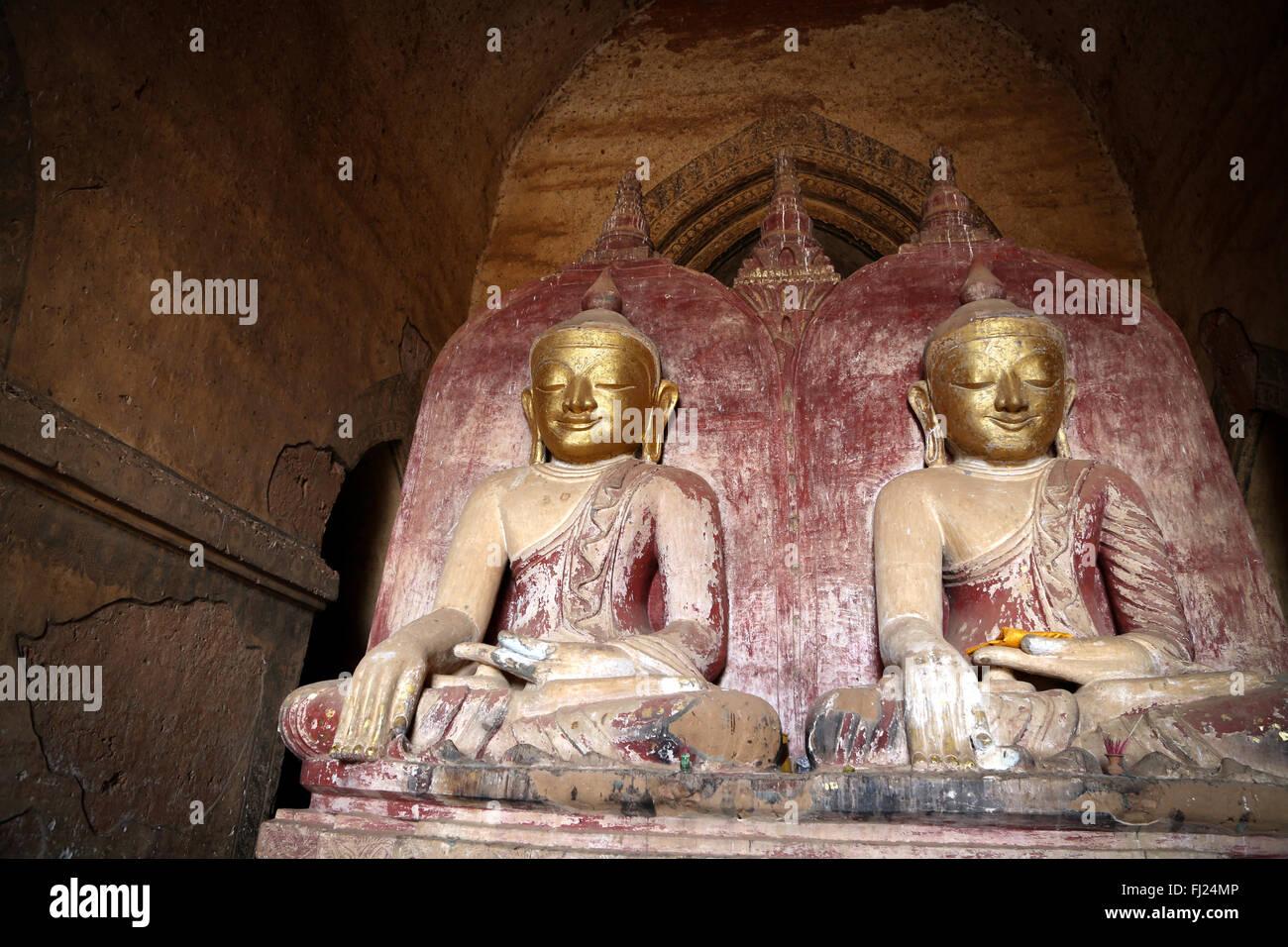 Twin Buddhas of the Dhammayangyi Temple, Bagan, Myanmar - Stock Image