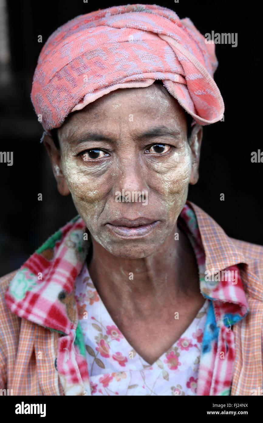 Burmese woman in Rangoon, Myanmar, wearing thanaka powder on