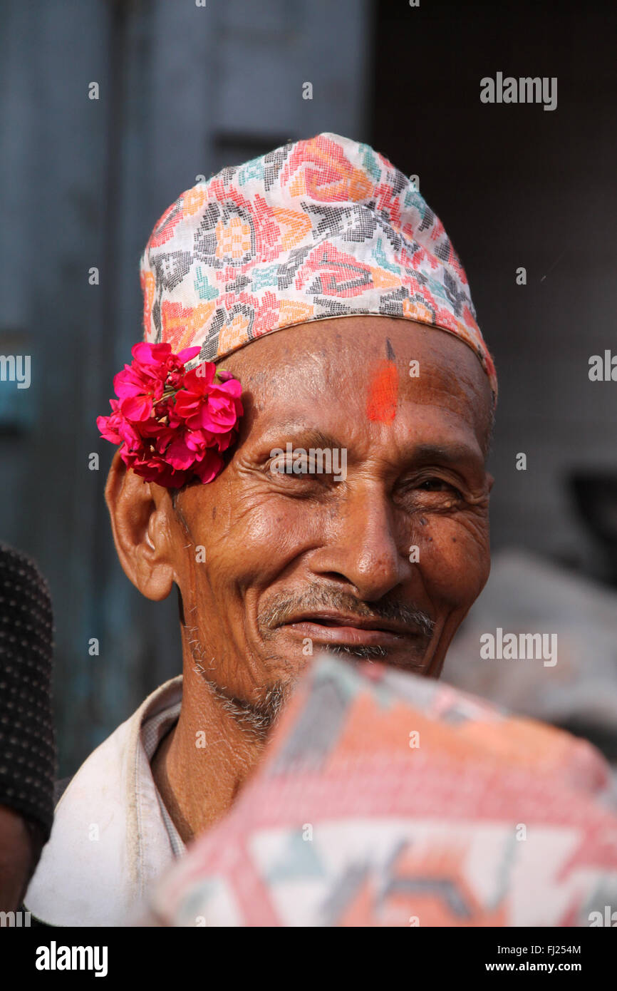 Portrait of Nepalese Newar man with tilak and traditional hat Dhaka topi in Patan - Stock Image