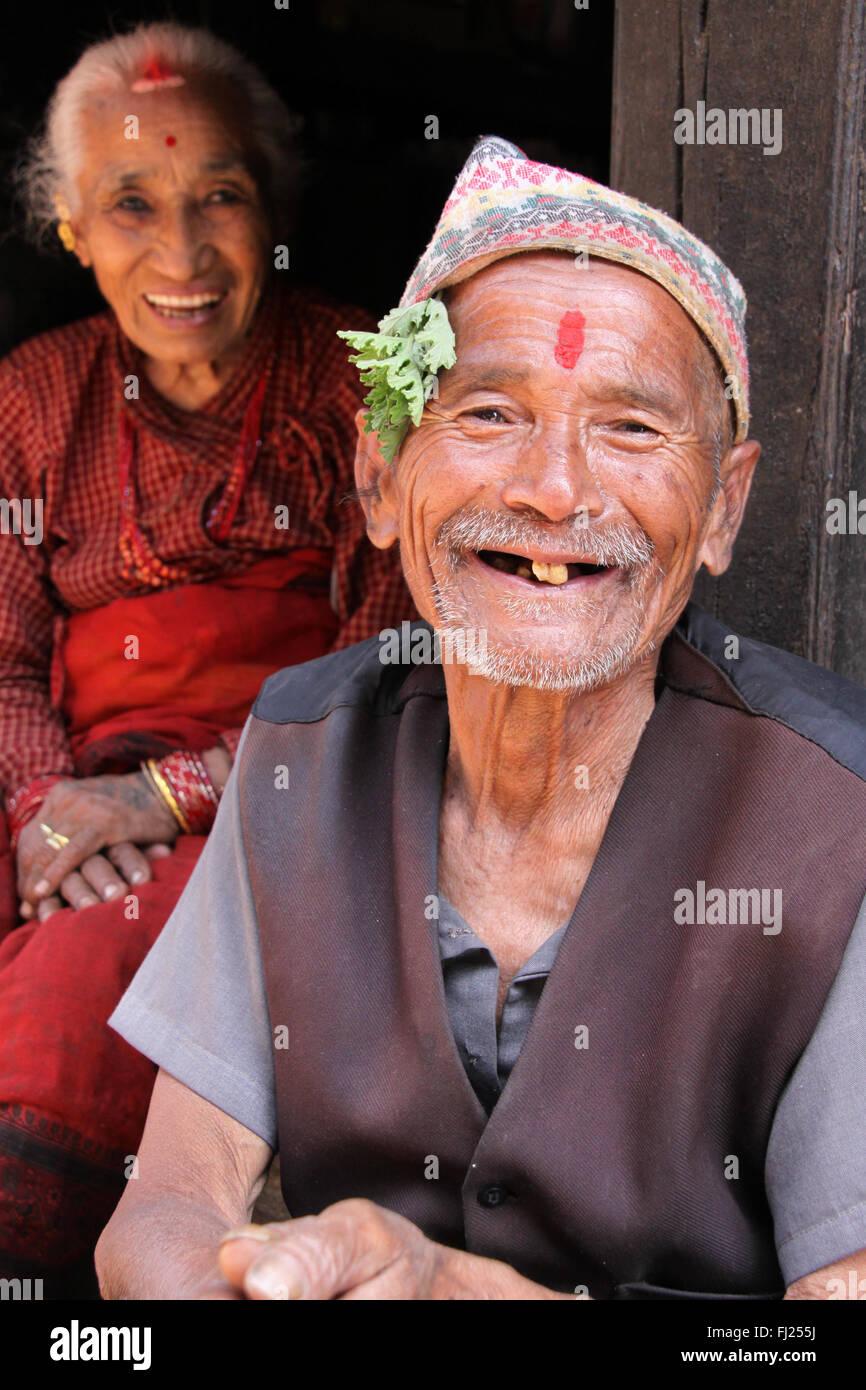 Portrait of old Nepali Newar couple, man wearing traditional hat,  Dhaka topi - Stock Image