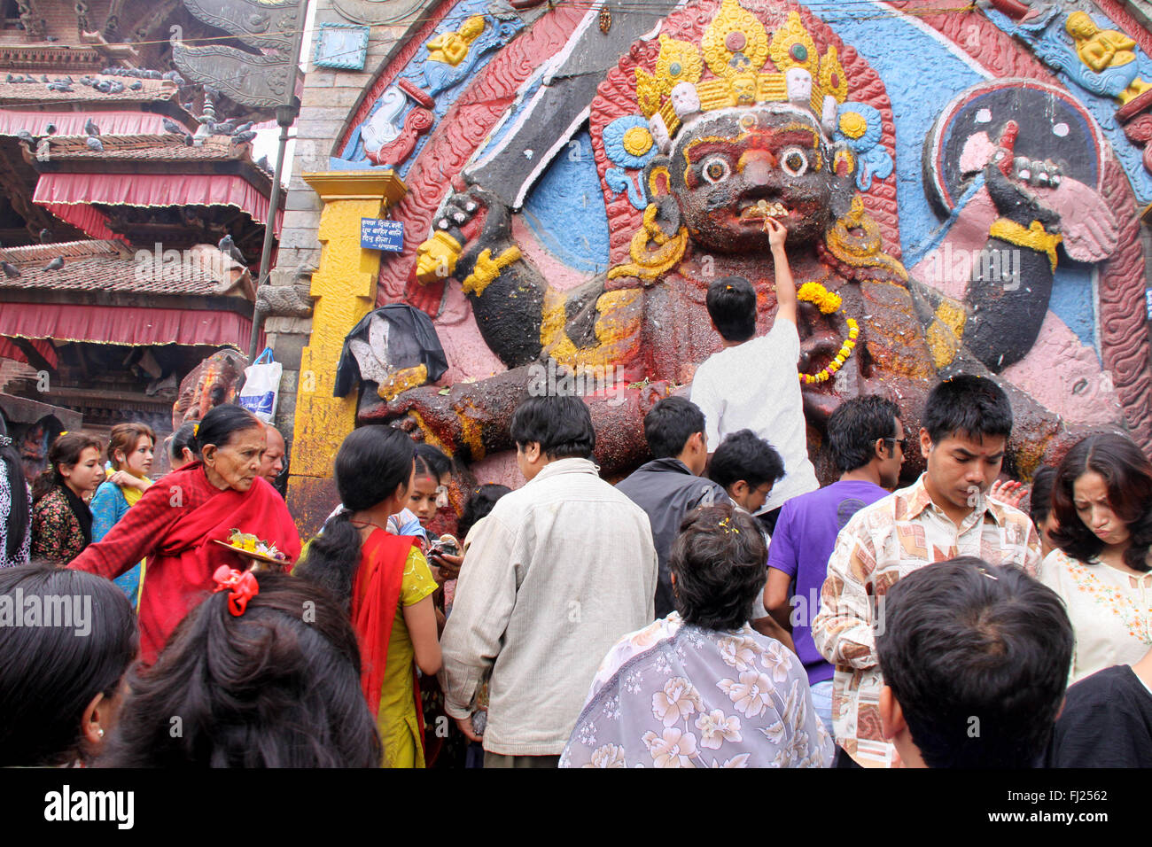 Kal Bhairab statue - Streetlife scene in Katmandu, Nepal, in the center of the capital and around Durbar square - Stock Image