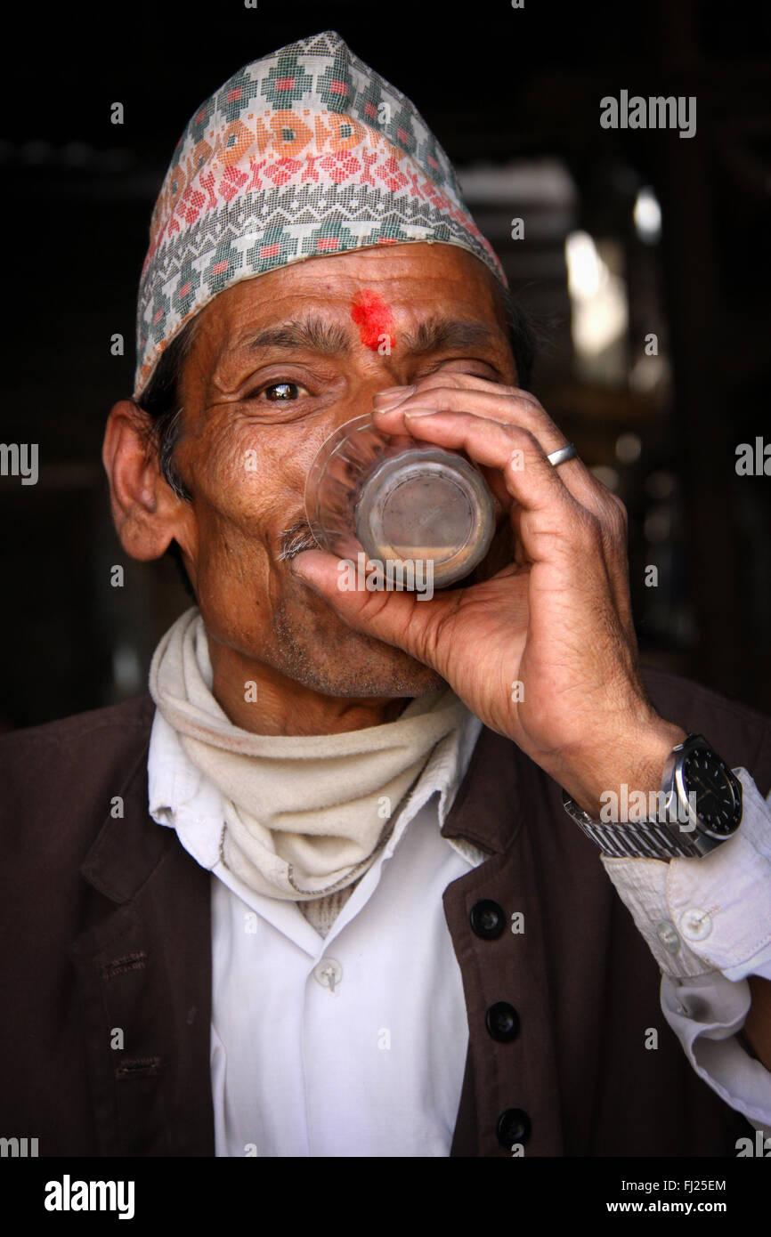 Portrait of Nepali Newar man with traditional hat Dhaka topi - Stock Image