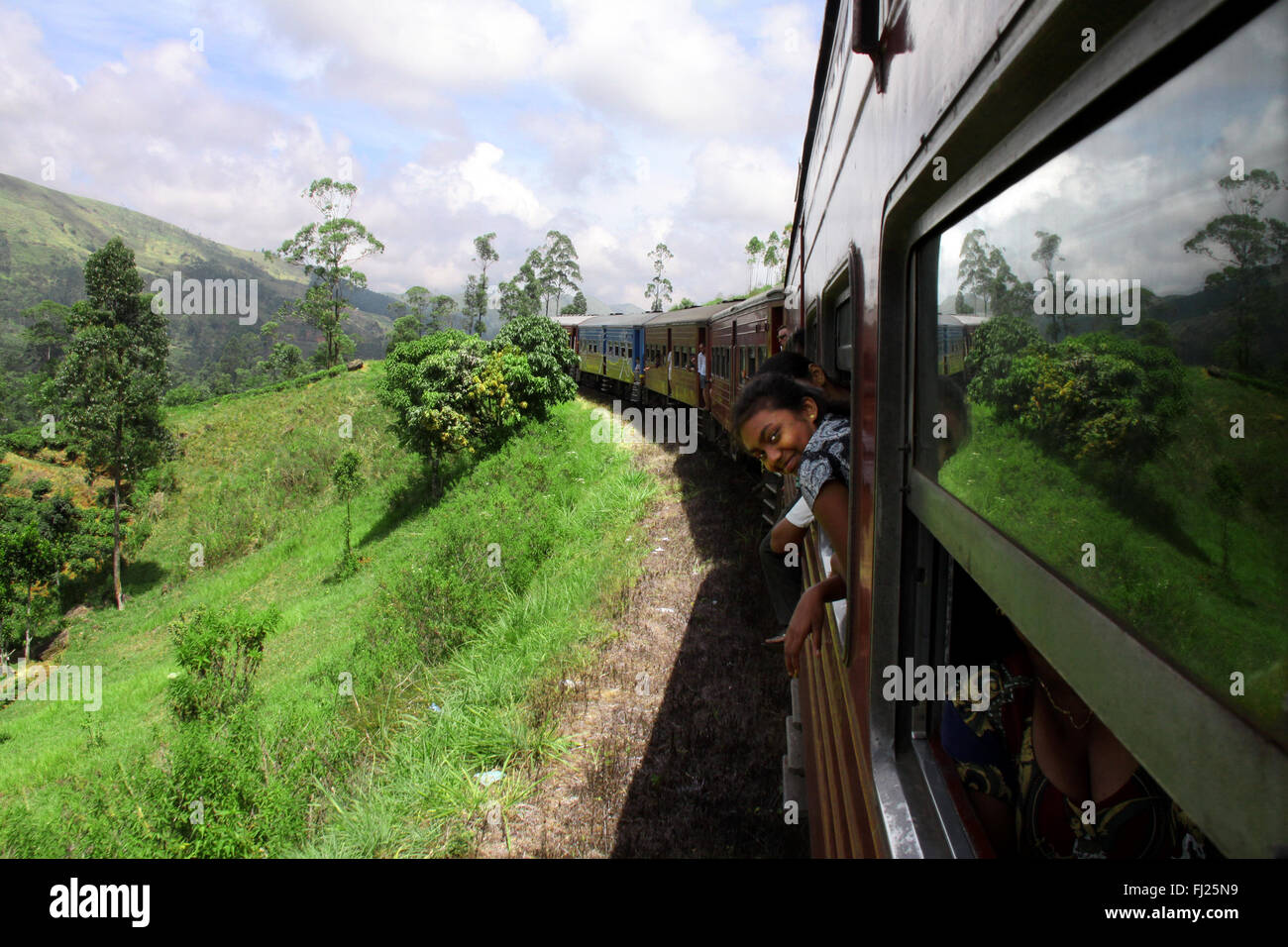 On the road on a train in green Sri Lanka in the middle of the island - Stock Image