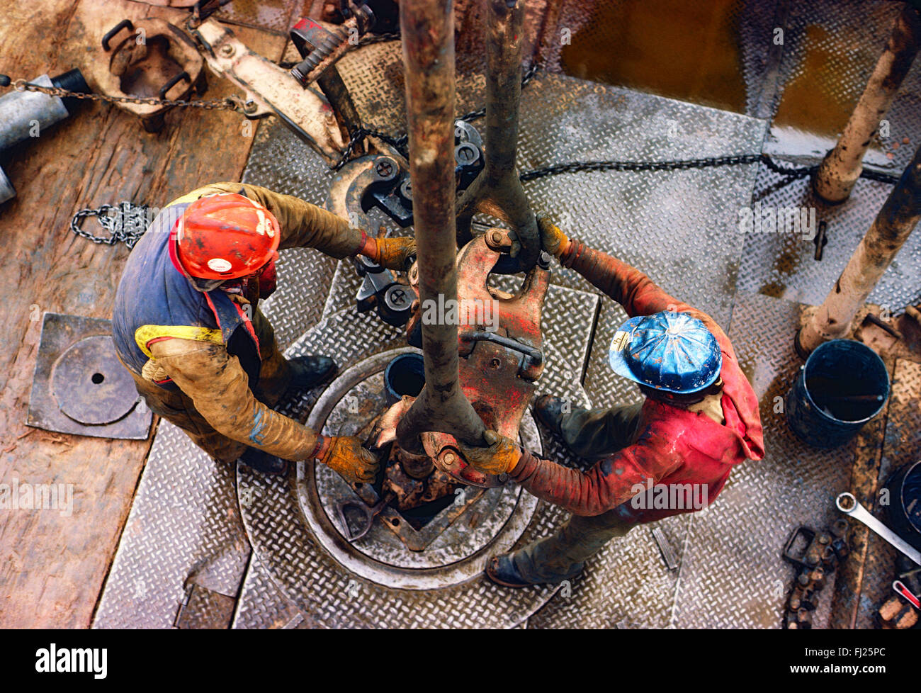 High view looking down on roughneck workers on oil rig, New Mexico, USA - Stock Image