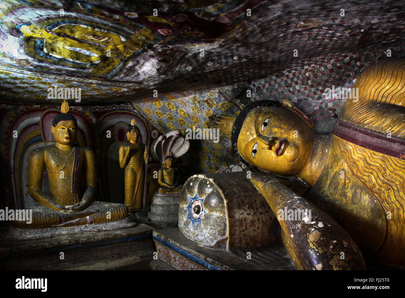 Dambulla cave in Sri Lanka - Buddha statue - Stock Image