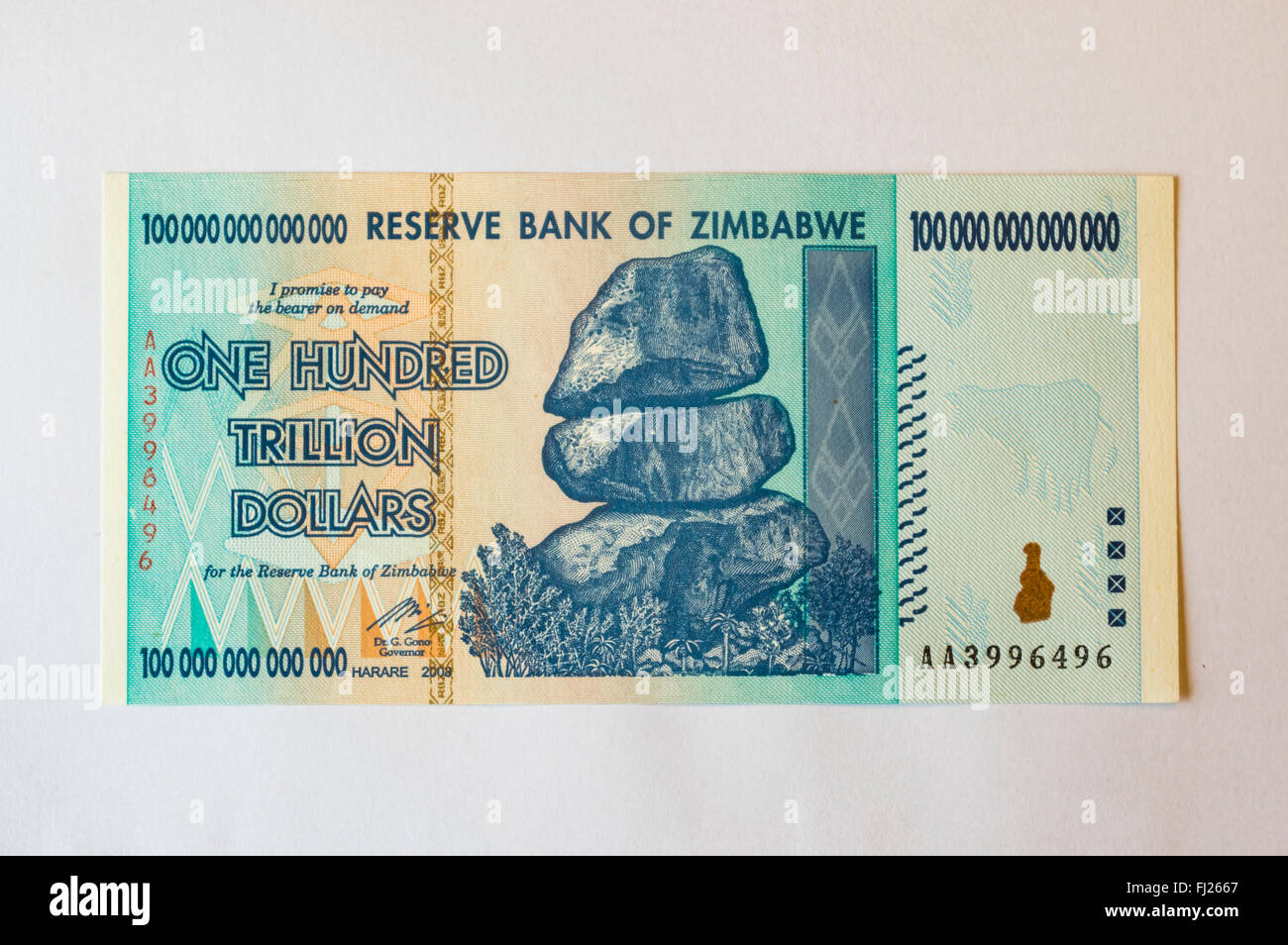 One hundred trillion dollars banknote issued in Zimbabwe in 2008, on the climax of the hyperinflation. White background. - Stock Image